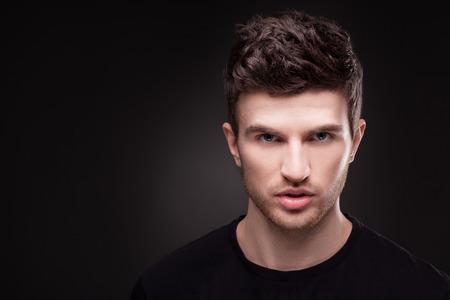 guy: Stylish guy close up portrait on black background