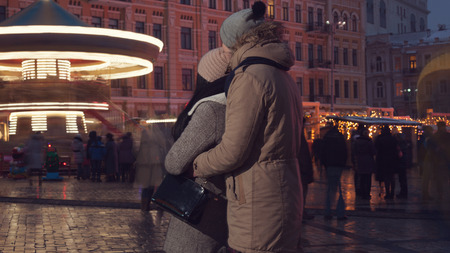 winter couple: couple on carousel background