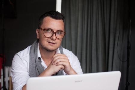 yuppie: Trendy man working in office Stock Photo