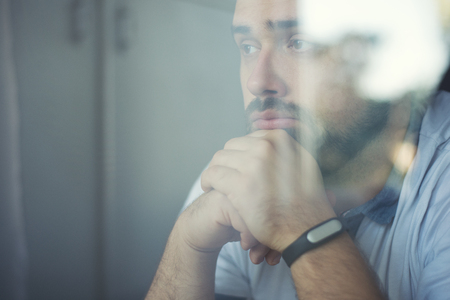 thinking man with fitness tracker in the office through glass window Reklamní fotografie