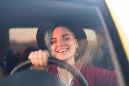 Creative person portrait in car