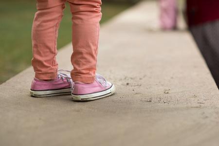 Close Up of kids sneakers walking on street Reklamní fotografie