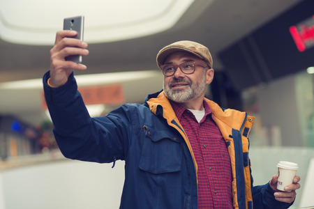Adult stylish man taking selfie