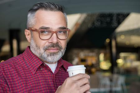 Stylish adult man drinking coffee Reklamní fotografie