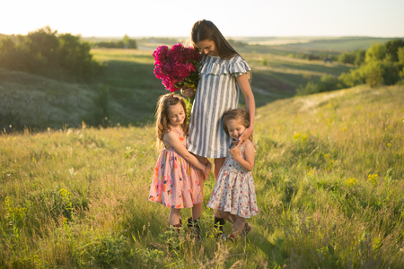 family portrait of mother with two daughters during nature stroll Reklamní fotografie