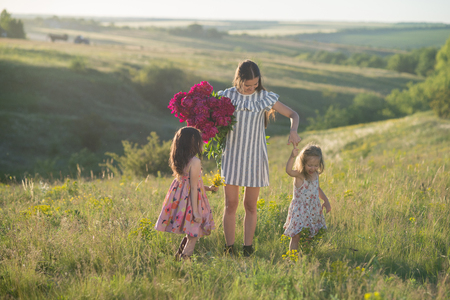 dancing happy family at summertime