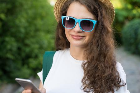 Girl traveler using smartphone on street Reklamní fotografie