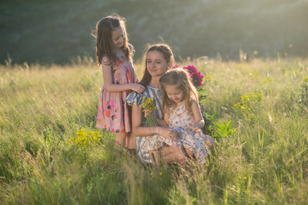 family portrait of mother with two daughters during nature stroll Stock Photo