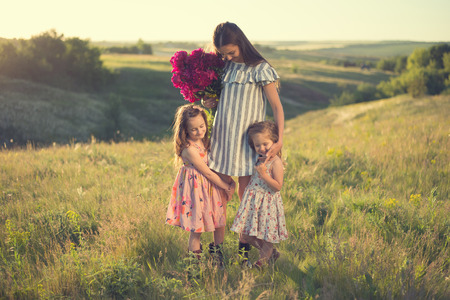 family portrait of mother with two daughters during nature stroll Stockfoto