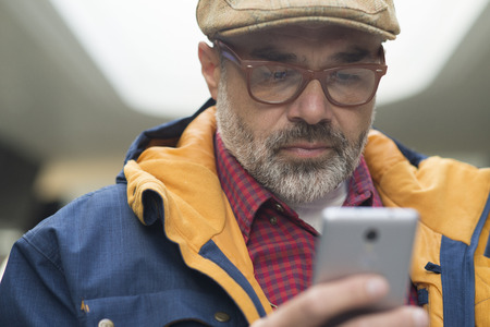 Adult man using smartphone application Stockfoto