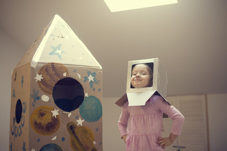 Little astronaut ready to travel to the stars. Playing with spaceship Standard-Bild - 97131294