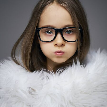 Portrait of stylish fashionista little girl face