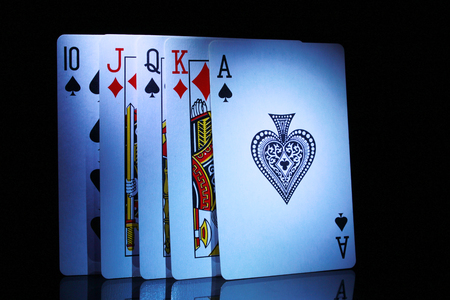 king and queen of hearts: some of playing cards, from ten to ace in dark