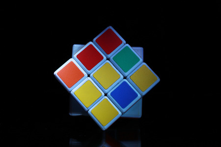 cube puzzle: Six color cube puzzle with clipping path in dark