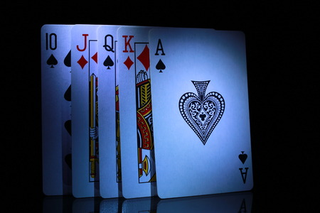 ace: some of playing cards, from ten to ace in dark
