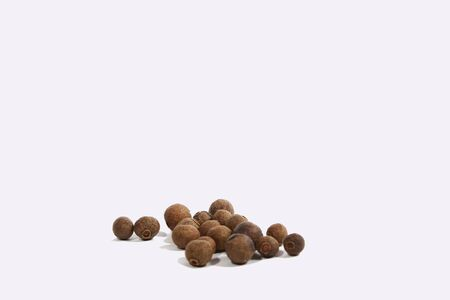 indian cookery: Black pepper was placed on a white background