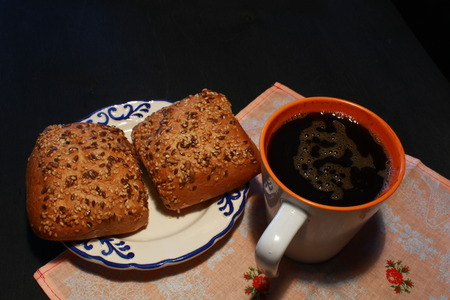 color photo: Color photo of a cup of coffee and two buns