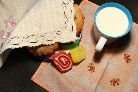 choco chips: Homemade muffins and cup of milk on wooden background Stock Photo