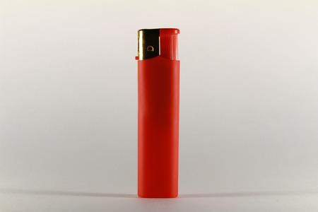 gas lighter: Red cigarette gas lighter on white background