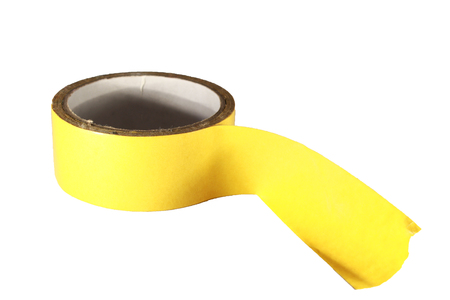 sellotape: Colored yellow adhesive tape on a white background.