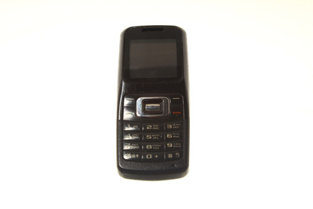 gsm phone: old black mobile phone on white background