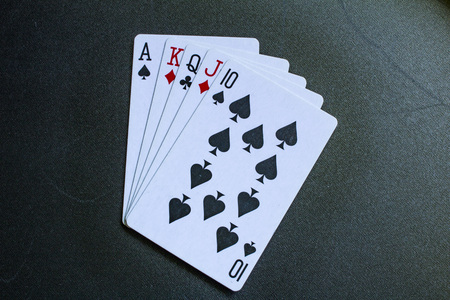 hold em: Playing card. Ten to ace on a black background