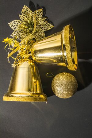 Bells with Christmas decoration on black background