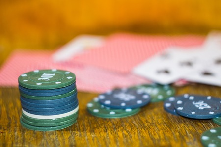 lear: Green, blue chips and cards for poker