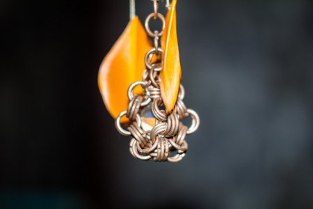 ball and chain: glass ball encased in a steel ring with orange feathers