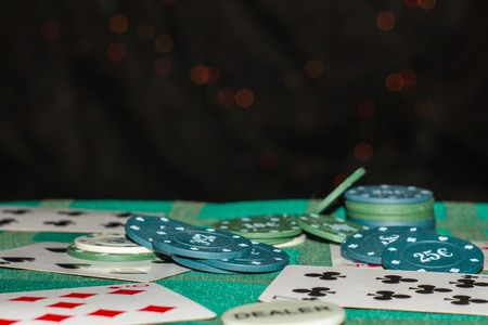 Blur background cards, chips in casino and few colors