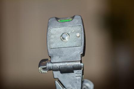 old tripod closeup on blur background
