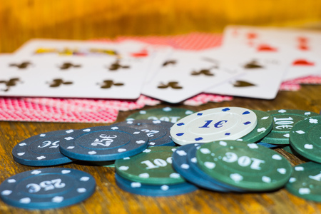 Green, blue chips and cards for poker