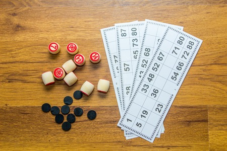 Cards and kegs for lotto- bingo game on wooden background