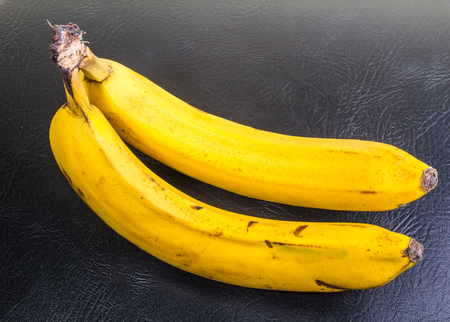 two yellow over ripe bananas