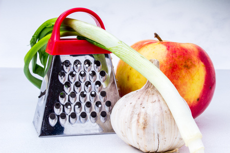 metal grater: Still life: vegetables and fruits.apple, garlic, onion with small grater