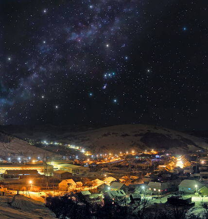 Picturesque mountain town on a winter night Archivio Fotografico