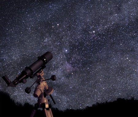 Telescope under starry skies