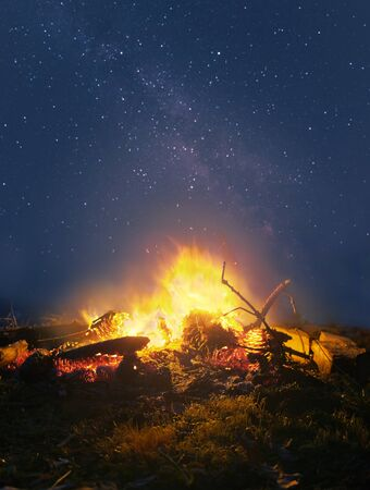 Bright campfire against the starry night sky