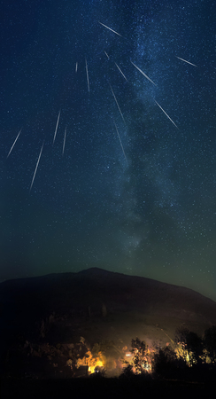 Starry sky and shooting stars over the mountain