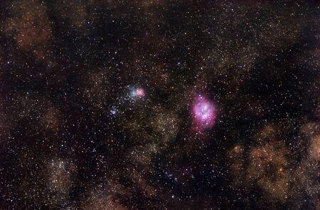 Bright nebulae shining among the stars of Milky Way Stock fotó