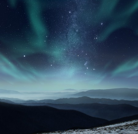 Starry night sky with aurora polaris over the mountains Stock fotó - 58768004