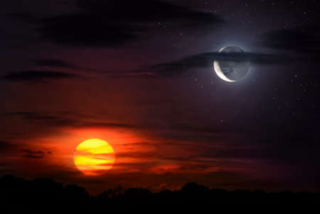 Sun and moon together on the sky symbolizing time, opposites, harmony etc
