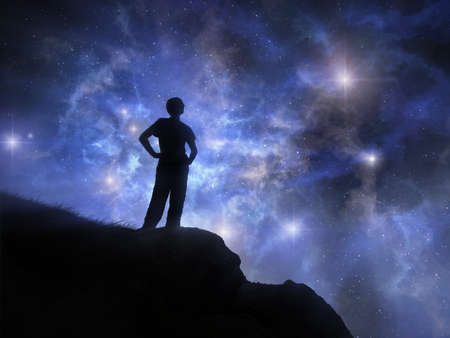A man is standing on the cliff against the starry sky