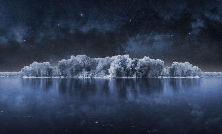 A picture of icy lake reflecting the starry night sky above it