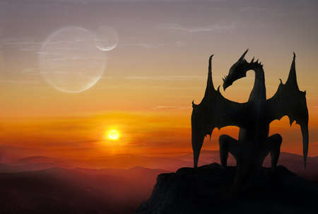 Black dragon is sitting on a stone against setting sun Banque d'images