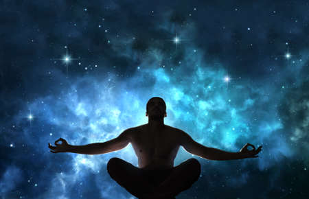 Silhouette of meditating man against the cosmic background