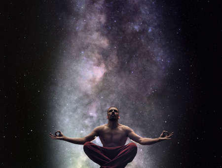 Meditating man against Milky Way and the stars Stock fotó