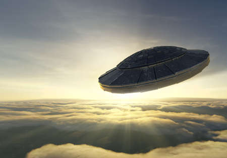 Alien spacecraft is flying over the clouds against sunset