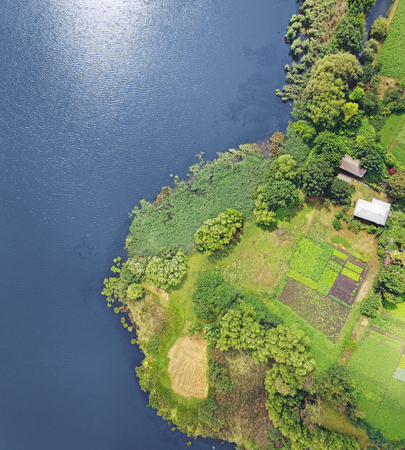 Aerial picture of the riverside with fields and meadows
