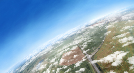 Aerial panorama of the farmlands and white clouds above them